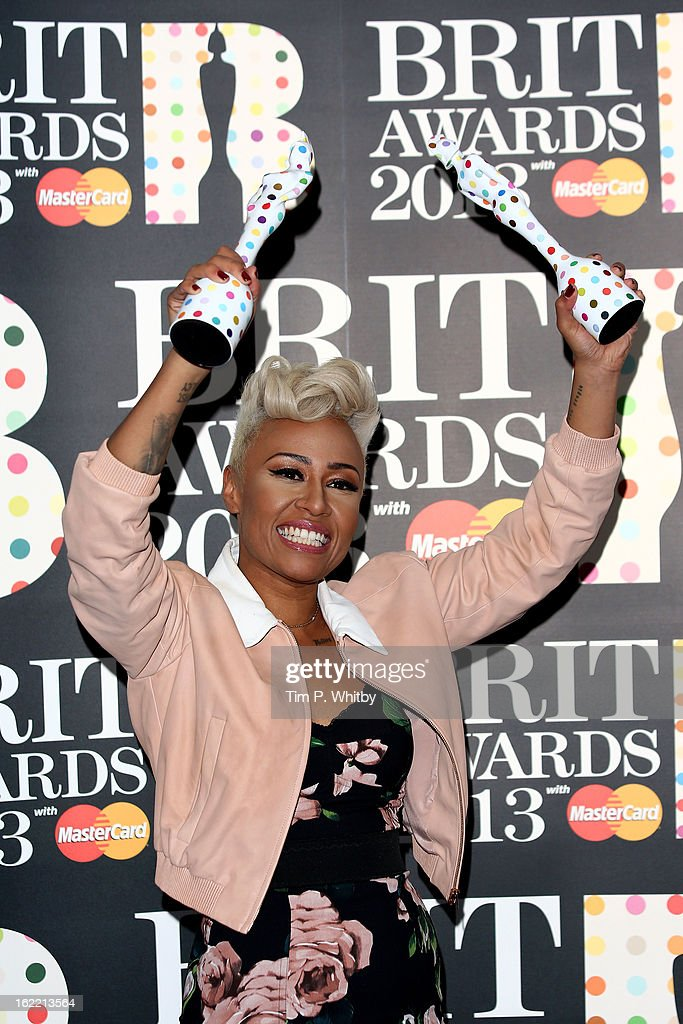 Emeli Sandé poses with her British Female Solo Artist and Mastercard British Album of the Year awards in the press room at the Brit Awards 2013 at the 02 Arena on February 20, 2013 in London, England.