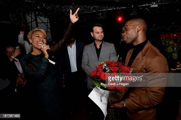 Emeli Sande sings Happy Birthday to Tinie Tempah during the Beats by Dre present Tinie Tempah's album launch party at DSTRKT on November 7 2013 in...