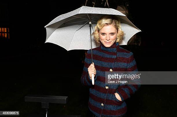 Emelia Fox turns on The Goring's Fulton Umbrella tree at The Goring Hotel on December 2 2013 in London England