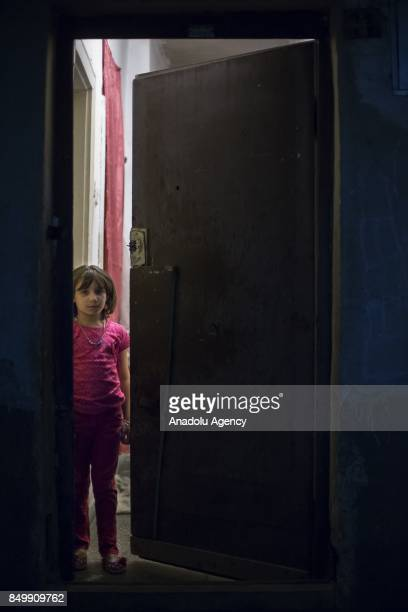 Emeni Omar looks behind of a half way open door in Altindag district of Ankara Turkey on July 26 2017 Emeni Omar lost his father in an airstrike...