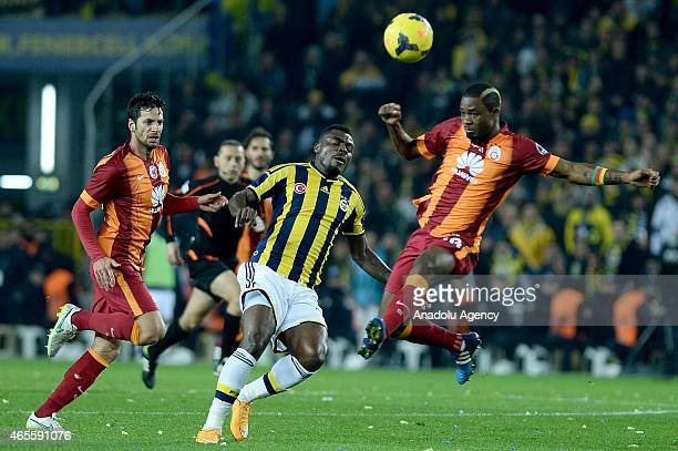 Emenike of Fenerbahce and Aurélien Chedjou of Galatasaray in action during the Turkish Spor Toto Super League derby game between Fenerbahce and...