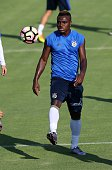 Emenike of Fenerbahce attends a training session prior to UEFA Champions League third preliminary lap match between Fenerbahce and Monaco at Can...