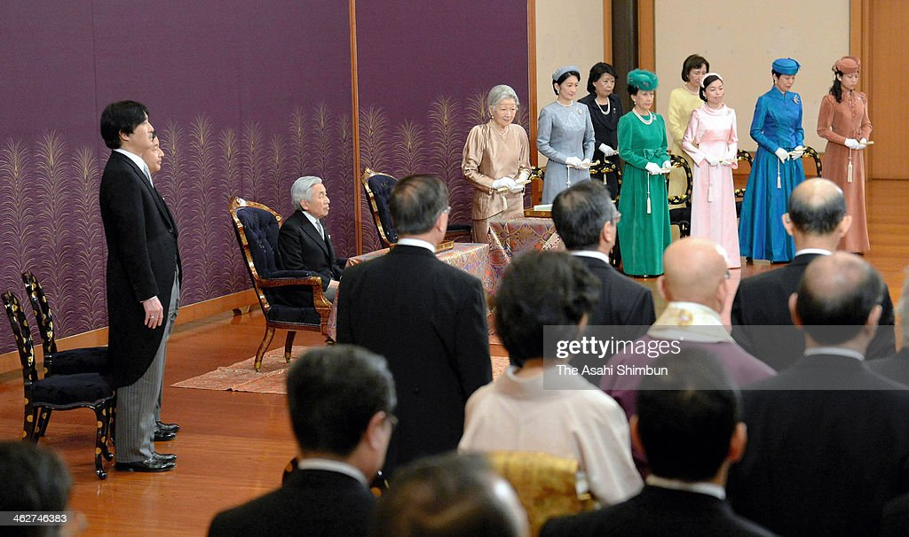 Emeperor Akihito (C) and royal family members attend the New Year Poetry Reading Ceremony at the Imperial Palace on January 15, 2014 in Tokyo, Japan.