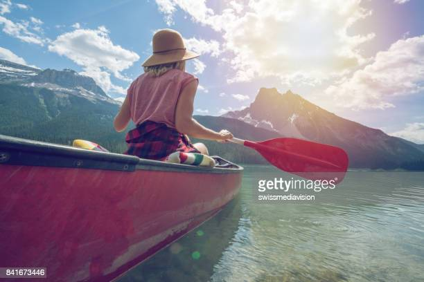 Emerald lake, Canada, Woman paddling canoe