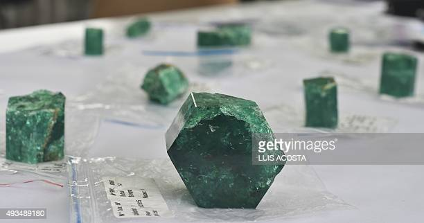 Emeralds are seen at the workshop of Muzo Emerald Company in Bogota on October 16 2015 Colombian emeralds are considered to be the most beautiful in...