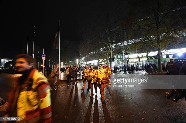 Emergancy service staff leave the stadium after the cancellation of the International friendly match between Germany and The Netherlands at the AWD...