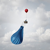 Emergency business plan and crisis management strategy metaphor as a businessman in a broken deflated hot air balloon being saved by a single small red party balloon as an innovative response solution