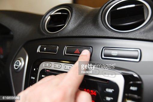emergency button on car dashboard : Stock Photo