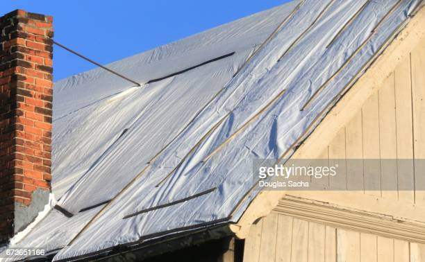Emergency covering attached to a damaged building roof