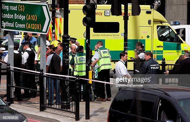 Emergency crew attend the incident around Hackney Road in Bethnal Green on July 21 2005 in London England Windows were blown out of the nearby number...