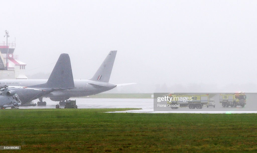 Emergency crews are seen on standby as an RNZAF C130 Hercules lands safely at Whenuapai Airport on June 29, 2016 in Auckland, New Zealand. Fire and rescue crews were on standby after the C-130 Hercules declared an emergency after reporting pressurisation issues in the air. There were 15 crew members on board.