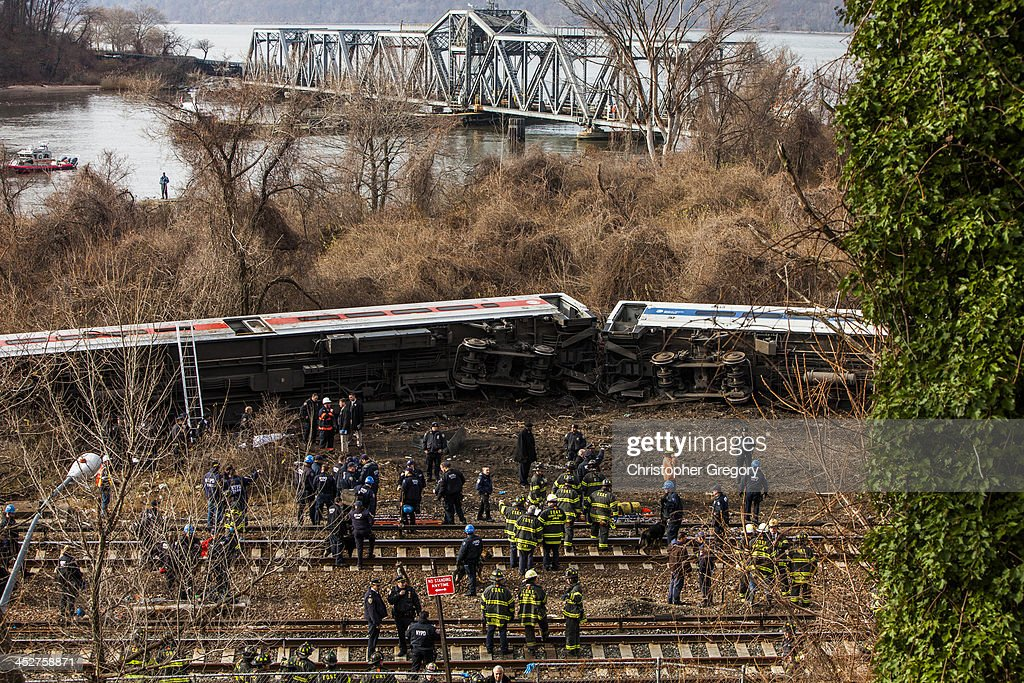 Emergency crews help injured passengers after Metro-North train derailed near the Spuyten Duyvil station December 1, 2013 in the Bronx borough of New York City. Multiple injuries and several deaths were reported after the seven car train left the tracks as it was heading to Grand Central Terminal along the Hudson River line.