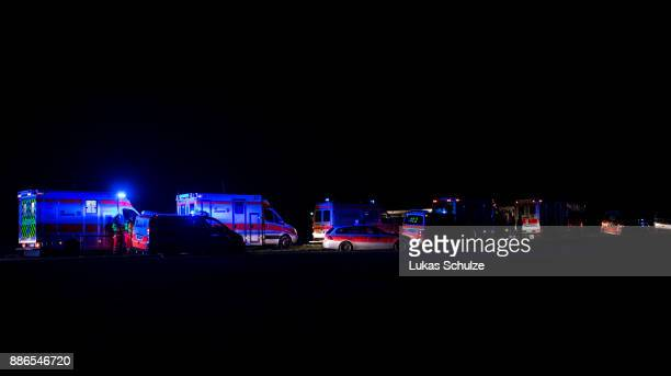Emergency crews stand near the wreckage of two trains that collided in MeerbueschOsterath district on December 5 2017 in Dusseldorf GermanyAccording...