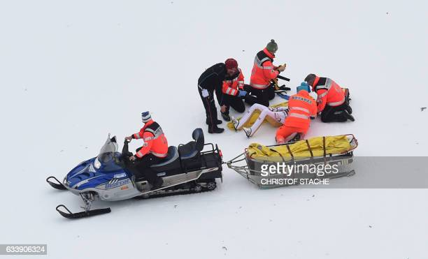 Emergency doctors help Austria's ski jumper Gregor Schlierenzauer after a crash during his qualification jump for a second FIS ski jumping World Cup...
