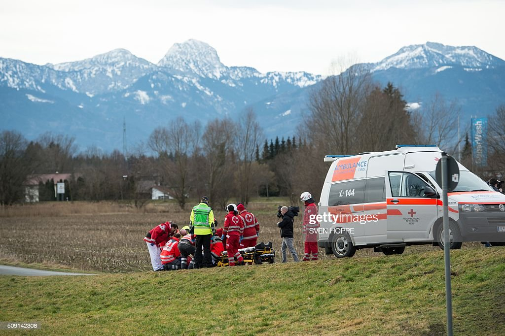 Emergency doctors work at the site of a train accident near Bad Aibling, southern Germany, on February 9, 2016. Two Meridian commuter trains operated by Transdev collided near Bad Aibling, around 60 kilometres (40 miles) southeast of Munich, killing at least four people and injuring around 100, police said. The cause of the accident was not immediately clear. / AFP / dpa / Sven Hoppe / Germany OUT