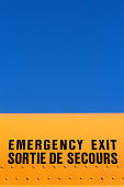 Emergency exit sign in English and French