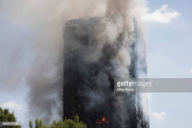 Emergency fire services tackle a blaze at Grenfell Tower near Notting Hill on 14th June 2017 in West London United Kingdom The huge fire engulfed the...