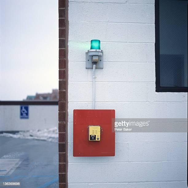 Emergency light on white wall