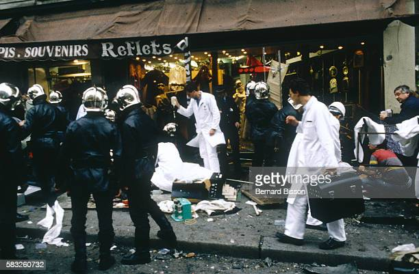 Emergency medical officers and police swamp the site of a bomb explosion at the Tati department store on Rue de Rennes The attack which kills five...