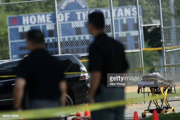 Emergency Medical Service personnel gather outside the Eugene Simpson Stadium Park where a shooting took place on June 14 2017 in Alexandria Virginia...