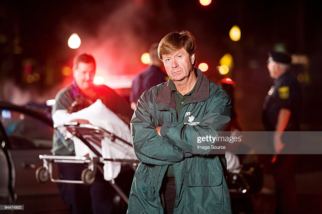 Emergency medical technician at scene of accident : Stock Photo