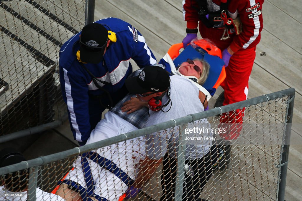 Emergency officials remove an injured fan from the stands following an incident at the finish of the NASCAR Nationwide Series DRIVE4COPD 300 at Daytona International Speedway on February 23, 2013 in Daytona Beach, Florida.
