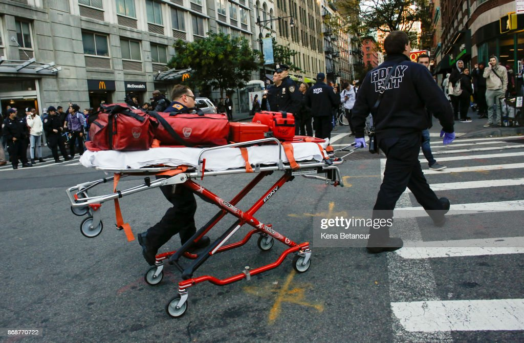 Emergency personal respond after a man driving a rental truck struck and killed eight people on a jogging and bike path in Lower Manhattan on October 31, 2017 in New York City. Officials are reporting up to 8 dead and at least 15 people have been injured.
