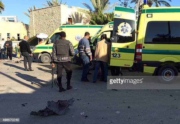 Emergency personnel and security forces stand next to ambulances outside the Swiss Inn hotel in the Egyptian town of ElArish in the Sinai peninsula...