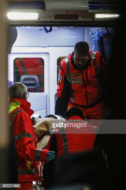 Emergency personnel arrive with the three children rescued from the avalanche that engulfed the Hotel Rigopiano at the Pescara Central hospital in...