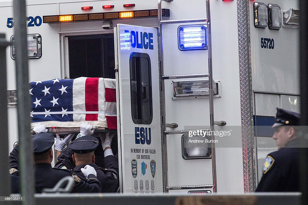 Emergency personnel carry caskets holding the unidentified remains of victims of the September 11, 2001 attacks onto the World Trade Center site, where they will be kept at the 9-11 Museum on May 10, 2014 in New York City. The decision by city officials to keep the remains at the museum until they are able to be identified has drawn both support and criticism by families of victims. A protest was held by a small group of people in protest to the decision as the remains were moved early this morning.