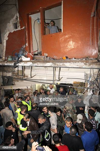 Emergency personnel gather at the site of a twin suicide bombing in Burj alBarajneh in the southern suburbs of the capital Beirut on November 12 2015...
