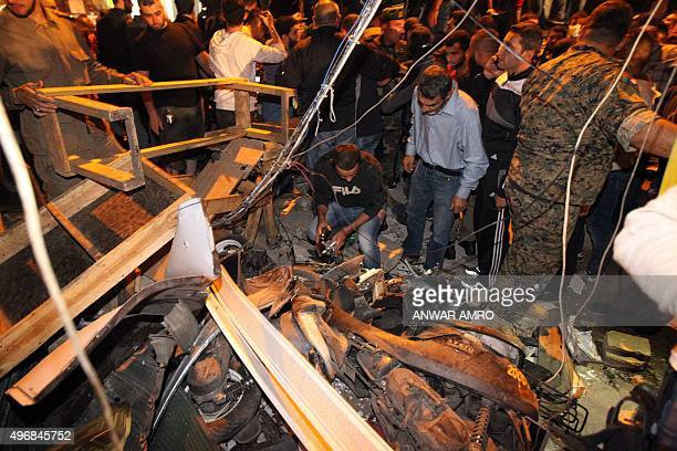 Emergency personnel inspect the debris at the site of a twin suicide bombing in Burj alBarajneh in the southern suburbs of the capital Beirut on...