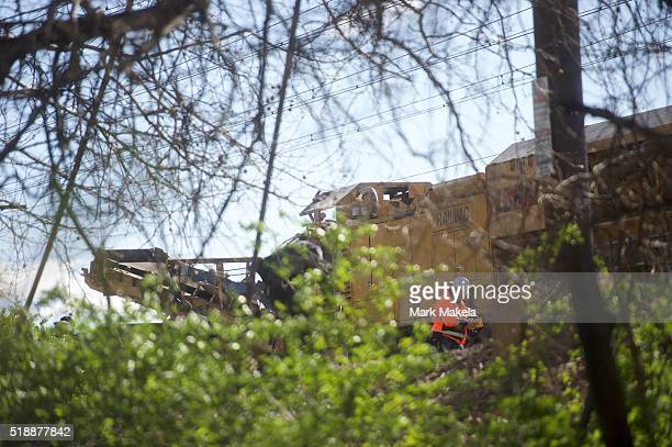 Emergency personnel investigate the backhoe involved in the crash of Amtrak Palmetto train 89 on April 3 2016 in Chester Pennsylvania Two people are...