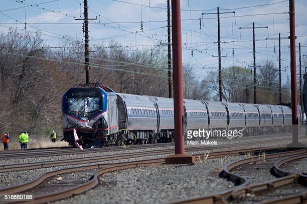 Emergency personnel investigate the crash site of Amtrak Palmetto train 89 on April 3 2016 in Chester Pennsylvania Two people are confirmed dead...