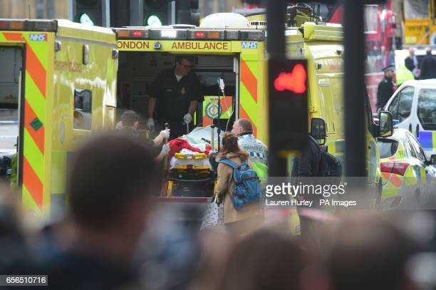 Emergency personnel on Westminster Bridge close to the Palace of Westminster London after at least two people have died after a knifeman brought...
