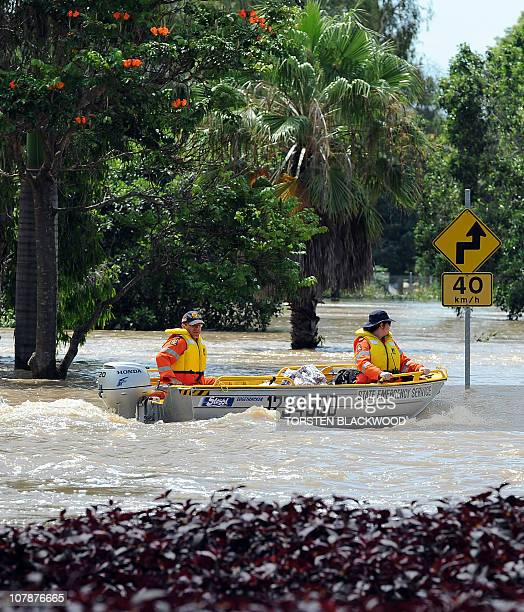 Emergency personnel patrol the flooded Bruce Highway by boat after the Fitzroy River broke its banks and inundated much of Rockhampton on January 4...
