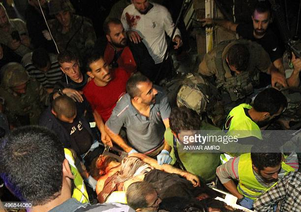 Emergency personnel remove a body from the site of a twin suicide bombing in Burj alBarajneh in the southern suburbs of the capital Beirut on...