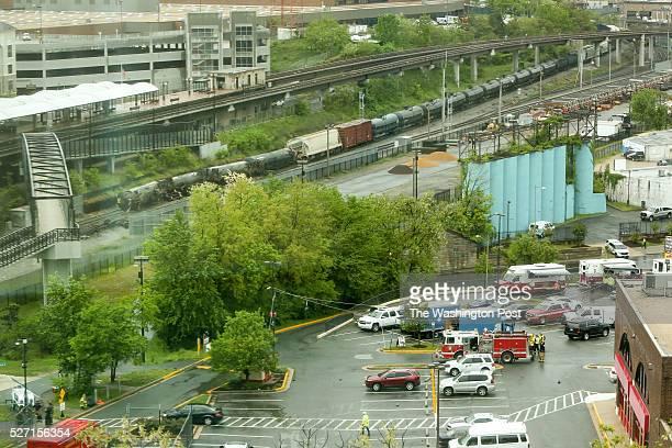 Emergency personnel respond to the scene of a CSX train derailment near the Rhode Island Ave Metro in NE Washington DC May 1 2016 The 175car train...