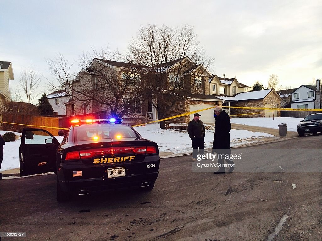 Emergency personnel surround the suspected gunman's family home in Highlands Ranch, Colo. after a reported shooting at Arapahoe High School in Centennial on Friday, Dec. 13, 2013.