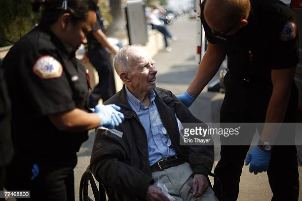 Emergency personnel transport elderly patients from the Del Mar Fairgrounds October 23 2007 in San Diego California Besides local residents thousands...