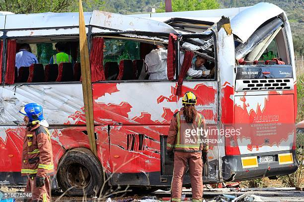 Emergency personnel watch as police search a bus on the Spanish AP7 motorway near Freginals Amposta south of Tarragona following a fatal bus accident...