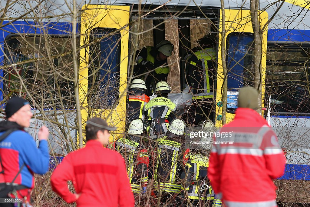 Emergency Rescue workers carrying a victim at the wreckage of two trains that collided head-on several hours before in Bavaria on February 9, 2016 near Bad Aibling, Germany. Authorities say at least four people are dead and over 150 injured in the collision between two trains of the Meridian local commuter train service that occurred at approximately 7 am.