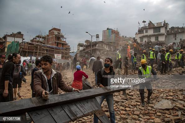 Emergency rescue workers clear debris in Basantapur Durbar Square while searching for survivors on April 25 2015 in Kathmandu Nepal More than 100...