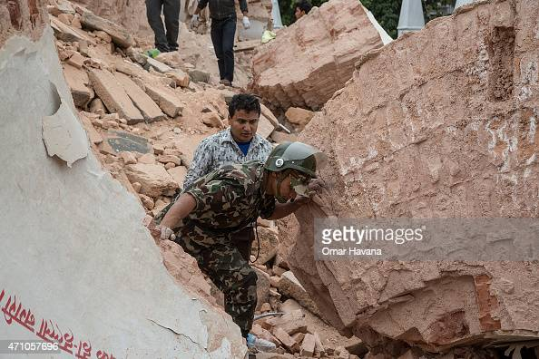 Emergency rescue workers search for survivors in the debris of Dharara tower after it collapsed on April 25 2015 in Kathmandu Nepal More than 100...