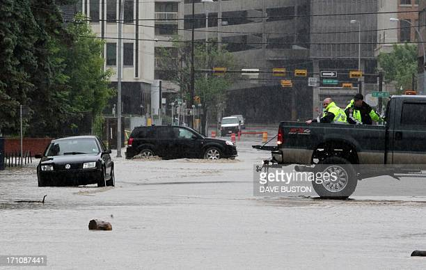 Emergency responce members patrol downtown streets as waters rise in Calgary Alberta Canada June 21 2013 Flooding forced the evacuation of some...