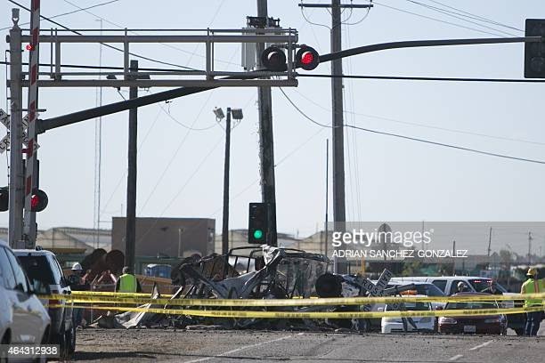 Emergency responders at the scene where a MetroLink commuter train collided with a truck and derailed injuring at least 28 people February 24 in...