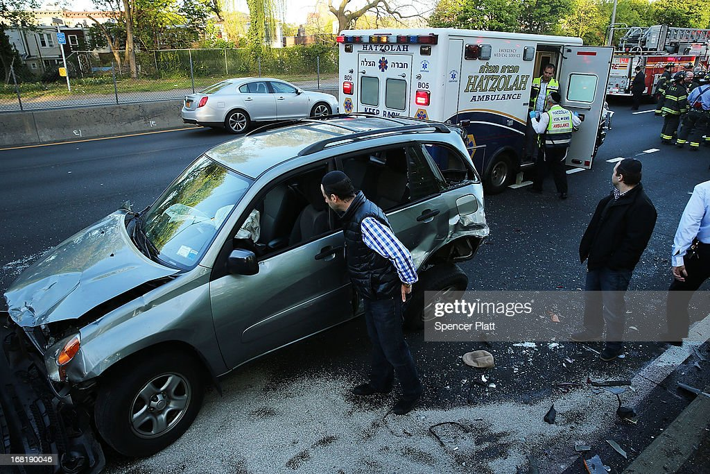 Emergency responders work at the scene of a multi-car accident on May 6, 2013 in the Brooklyn borough of New York City. It was reported that seven people were aided in the early evening pile-up, which occurred on the Prospect Expressway.