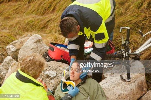 Emergency Response Team Attending Injured Woman