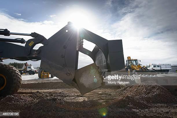 Emergency Response Team digger lifting blocks in training exercise