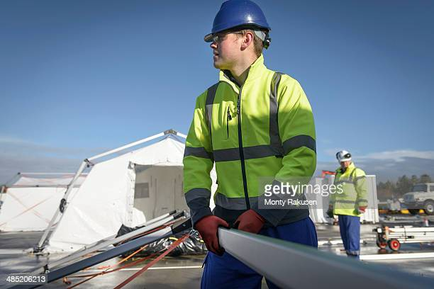 Emergency Response Team workers erecting tent control centre